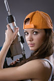 Sexy young woman construction worker Stock Photos