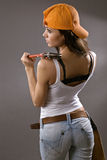 Sexy young woman construction worker Stock Images