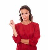 Sexy young woman conversing on earphone Stock Photos