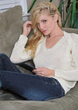 young woman on couch with tablet Stock Images