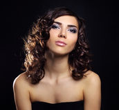 Sexy young woman with curly hair Stock Photo