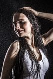 Sexy young woman dancing under the rain Royalty Free Stock Images
