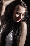 Sexy young woman dancing under the rain Stock Photography