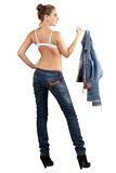 Sexy young woman in a denim suit Stock Photography