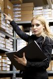 Sexy young woman doing inventory Royalty Free Stock Images
