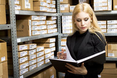 Sexy young woman doing inventory Stock Photos