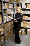 Sexy young woman doing inventory Royalty Free Stock Photos