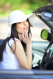 Sexy young woman driving black car. Royalty Free Stock Photo