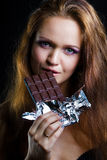 Sexy young woman eating chocolate Stock Photography