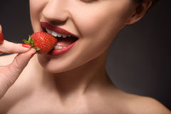 Sexy young woman eating sweet food Royalty Free Stock Photo