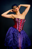 Girl in a red corset on a dark background Royalty Free Stock Photo