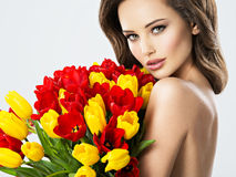 Sexy young woman with flowers. Stock Photography