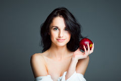 young woman with fresh red apple stock photos