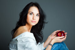 Sexy young woman with fresh red apple Stock Photos