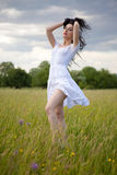 Sexy  young woman on grass field Stock Photography