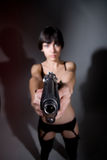 Sexy young woman with a gun Royalty Free Stock Images