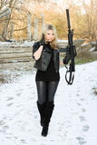 Sexy young woman with a gun Royalty Free Stock Photography