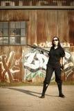 Sexy young woman with gun Stock Photos