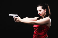 Sexy young woman - gun on black background Stock Photos