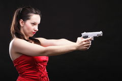Sexy young woman - gun on black background Stock Photo
