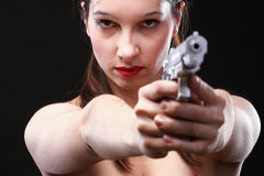 young woman with gun on black Royalty Free Stock Photography