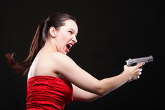 young woman - gun on black background Royalty Free Stock Image