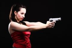 Sexy young woman - gun on black background Stock Photos