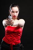 Sexy young woman - gun on black background Royalty Free Stock Photography