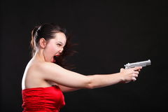 Sexy young woman - gun on black background Royalty Free Stock Photos