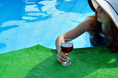 Sexy young woman in a hat with a wine glass, space for text. Royalty Free Stock Images
