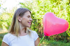 young woman with heart shaped balloon Royalty Free Stock Image