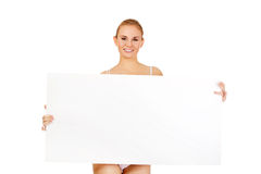 Sexy young woman holding empty board Stock Photo