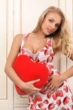 Sexy young woman holding heart. And looking at camera Royalty Free Stock Image