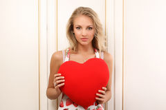 Sexy young woman holding heart Stock Photo