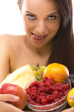 Sexy young woman holding a plate of fruit Royalty Free Stock Images