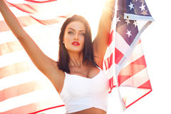 Sexy young woman holding USA flag Stock Photos