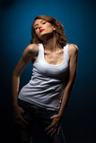 Sexy Young woman in jeans white tank top Royalty Free Stock Photography