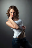 Sexy Young woman in jeans white tank top Royalty Free Stock Image
