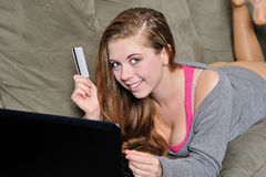 Sexy young woman with laptop computer shopping Stock Photo