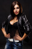 Sexy young woman in leather jacket Stock Image