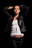 Sexy young woman in leather jacket and pants posing Stock Photography