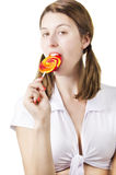 Sexy young woman licking lollipop Stock Images