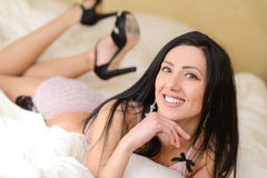 Sexy young woman in lingerie posing on the bed Royalty Free Stock Images