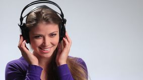 young woman listening to music playfully stock footage