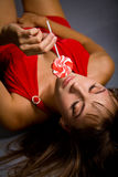 Sexy young woman with lollipop candy Stock Images