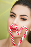 Sexy young woman with lollipops Stock Images
