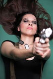 Sexy young woman long hair - gun Royalty Free Stock Photography