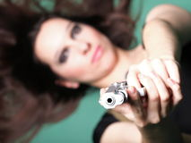 Sexy young woman long hair - gun Stock Photos