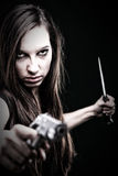 Sexy young woman long hair - gun knife Stock Photos