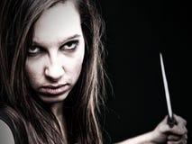 Sexy young woman long hair - gun knife Stock Image